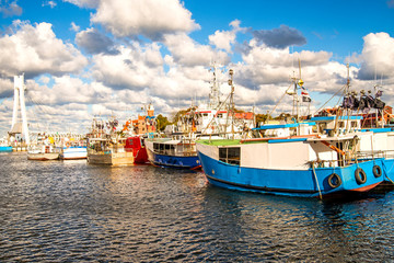 Fishing port of Ustka, Poland with old lighthouse