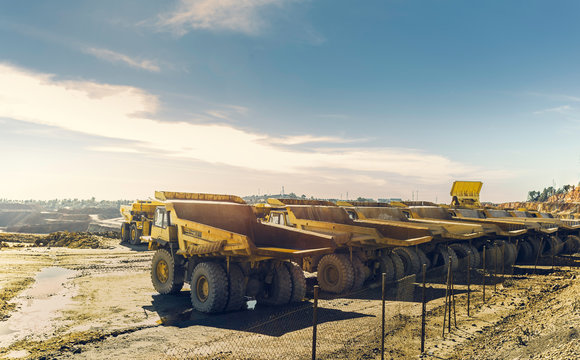 Large dumper trucks in the open pit mine of Riotinto, lined up waiting for their next assignment