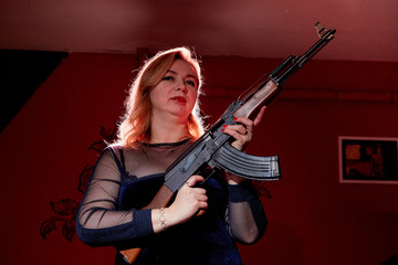 Fat women with guns in a dark room. Gangsters style