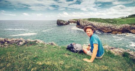 Backpacker traveler rest on the sea side