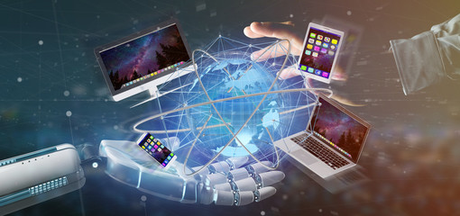 Cyborg hand holding a Computer and devices displayed on a futuristic interface with international network  - 3d rendering