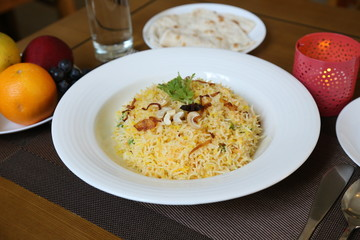 Vegetable briyani on white plate with lights