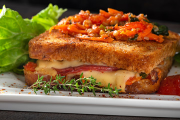 Worm sandwich made with cheese, salami and vegetables