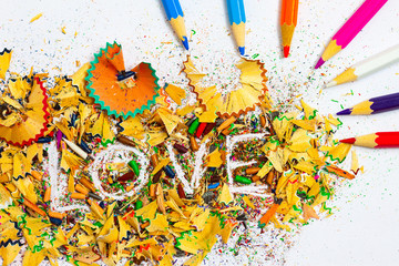 The word LOVE on the background pencil shavings