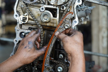 Hand working on car's engine