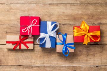 Many gift boxes on wooden background. Holiday concept, New Year, Christmas, Birthday, Valentine's Day. Flat lay, top view.