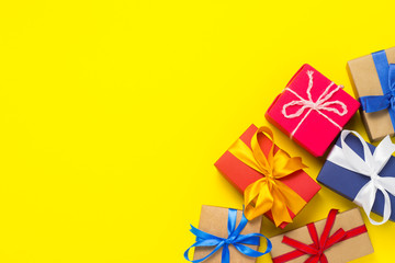 A lot of gift boxes on a yellow background. Holiday concept, New Year, Christmas, Birthday,...