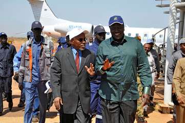 South Sudan's Oil minister Ezekiel Lul Gatkuoth and Sudan's oil minister, Azhari Abdel Qader arrive for a ceremony marking the restarting of crude oil pumping at the Unity oil fields