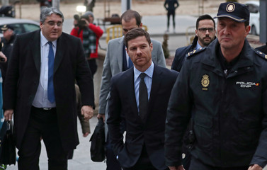 Spain's soccer player Xabi Alonso arrives to appear in court on a trial for tax fraud in Madrid