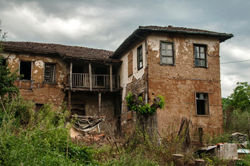 Old abandoned weathered retro vintage rural brick wall house