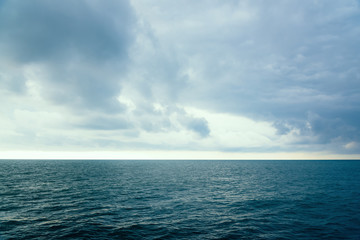 Cloudy evening sky over the sea surface of the water