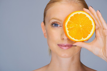 adult woman eyes Close up portrait  with orange