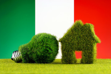 Green eco light bulb, eco house icon and Italy Flag. Renewable energy. Electricity prices, energy saving in the household.