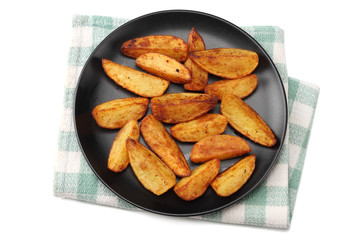 Fried potato wedges on black plate isolated on white background. top view. Fast food.