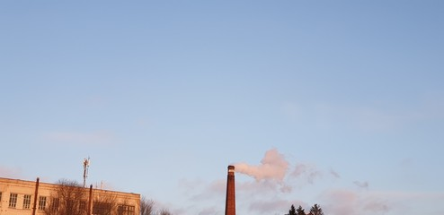 Keuken foto achterwand Marokko The work of the plant. Smoke from the factory chimney.