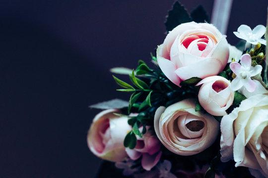 Pink Rose Wreath against a dark background