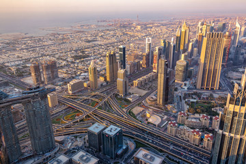 Aerial view of Dubai at sunset seen from Burj Khalifa tower, United Arab Emirates