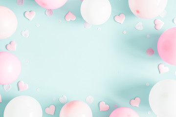 Balloons on pastel blue background. Frame made of white and pink balloons. Birthday, valentines day, holiday concept. Flat lay, top view, copy space