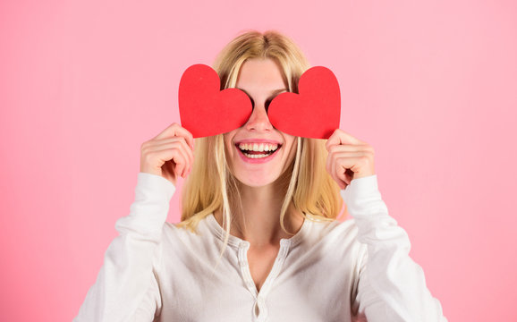 Girl cheerful fall in love. Girl hold heart symbol love and romantic pink background. Love is blind. Valentines day has traditionally been seen as more significant for women. Woman celebrate love
