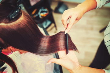 .Woman gets new hair color at the salon