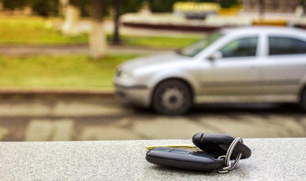 Lost car keys on the fallen needles of blue spruce. back blur background bokeh