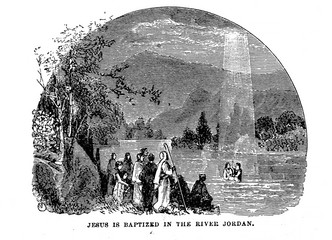 Jesus is baptized in the river Jordan