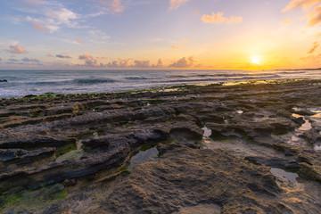 sunrise on coast of sea