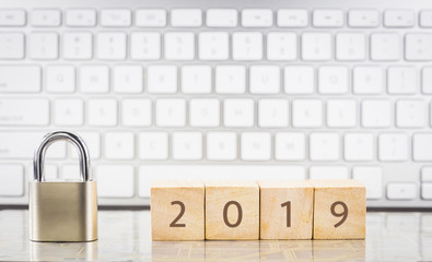 Close key lock with year number 2019, keyboard background.