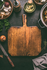 Empty cutting board food background. Rustic  table with ingredients and kitchen utensils . Cooking concept. Top view. Frame