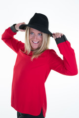 pretty blond woman hands on her black hat