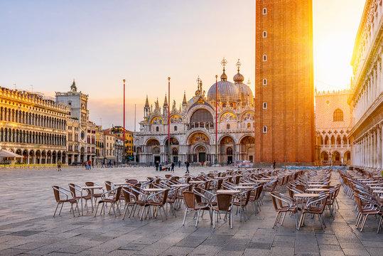 View of Basilica di San Marco and Campanile on piazza San Marco in Venice, Italy. Architecture and landmark of Venice. Sunrise cityscape of Venice.