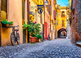 Cozy narrow street in Ferrara, Emilia-Romagna, Italy. Ferrara is capital of the Province of Ferrara Wall mural