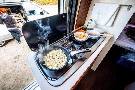Cooking dinner or lunch in campervan, motorhome or RV.
