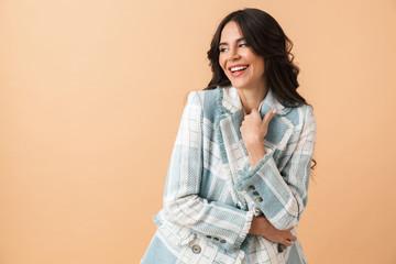 Beautiful brunette woman dressed in plaid jacket