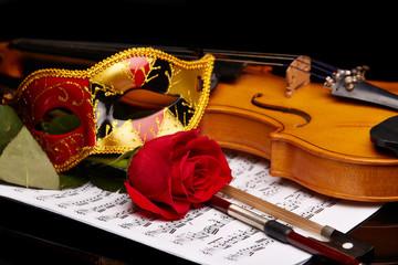 Violin, rose and notes.