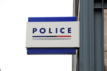 A logo of a Police station is seen in Paris