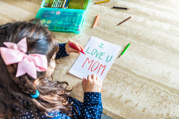 Little girl making a greeting card for Mother's Day