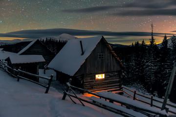 cozy light in wooden cabin in winter