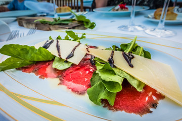 Carpaccio of veal on a white plate