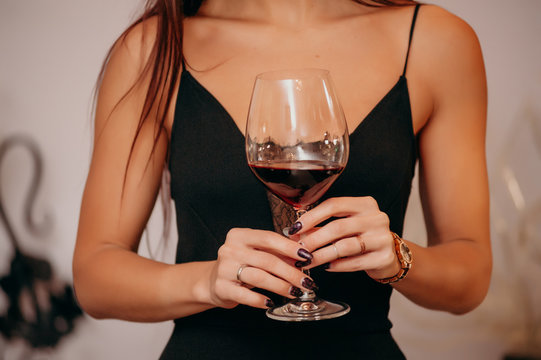 Close up hands of woman with wine glass