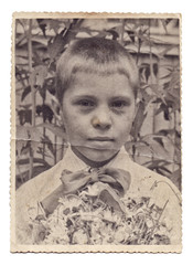 Vintage portrait photo of little boy isolated