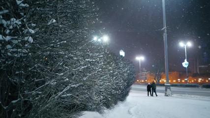 Fotobehang - Snowfall in night winter city. Yekaterinburg, Russia. Slow motion.