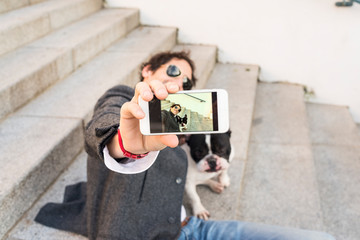 Man making a selfie with his dog