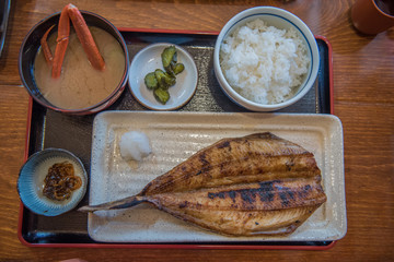 Popular Japanese fish grilled dish with rice eaten during winter.