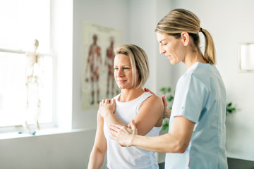 A Modern rehabilitation physiotherapy worker with woman client