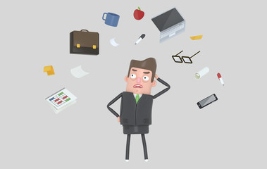 Businessman stressing looking at office accesories. Isolated.