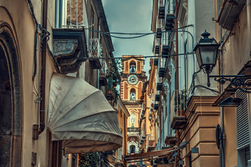 Foto op Plexiglas Smal steegje Sorrento Duomo seen through a narrow alley in old town