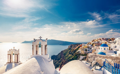 Wall Mural - Architecture of Oia village, Santorini island in Greece, on a sunny day with dramatic sky. Scenic travel background.