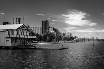 Perth seen from Elizabeth key including house of West Australian Rowing Club and fire brigade practicing in black and white