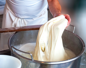 Homemade cheese producer, produces handmade mozzarella with fresh quality milk from her cows sheep in the morning.